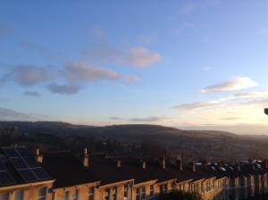 Solsbury Hill in the distance on a sunny day